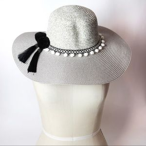 Grey embellished sun hat with tassels and pom poms